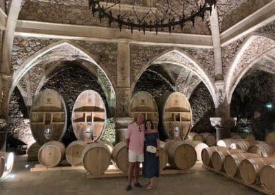 French Riviera Wine Tours - Couple enjoying a wine tour in Côtes de Provence, posing in the cellar of Font du Broc